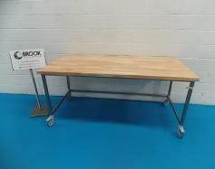 y086420-new-ex-display-2m-x-900mm-beach-top-table-stainless-legs-on-braked-wheels-alb1395.jpg